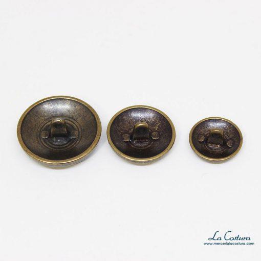 boton-metalico-escudo-dorado-envejecido-interior