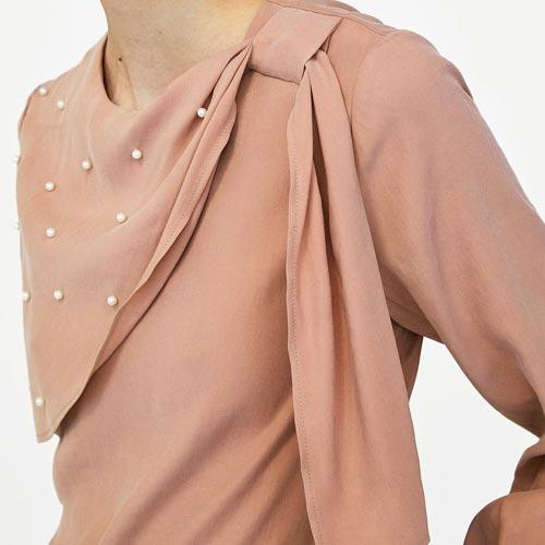 Blusa con perlas
