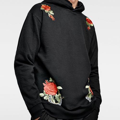 Sudadera hombre con parches florales