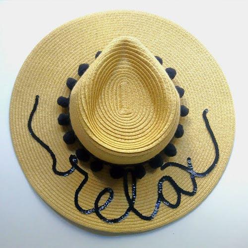 Sombrero de paja con lentejuelas y madroños
