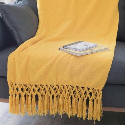 Manta con detalle de flecos de algodón