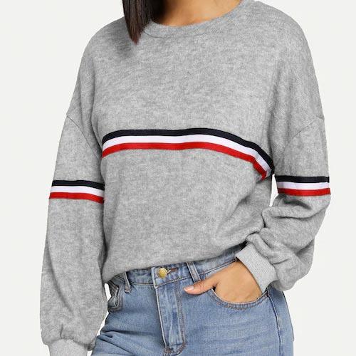 Suéter con banda central de rayas